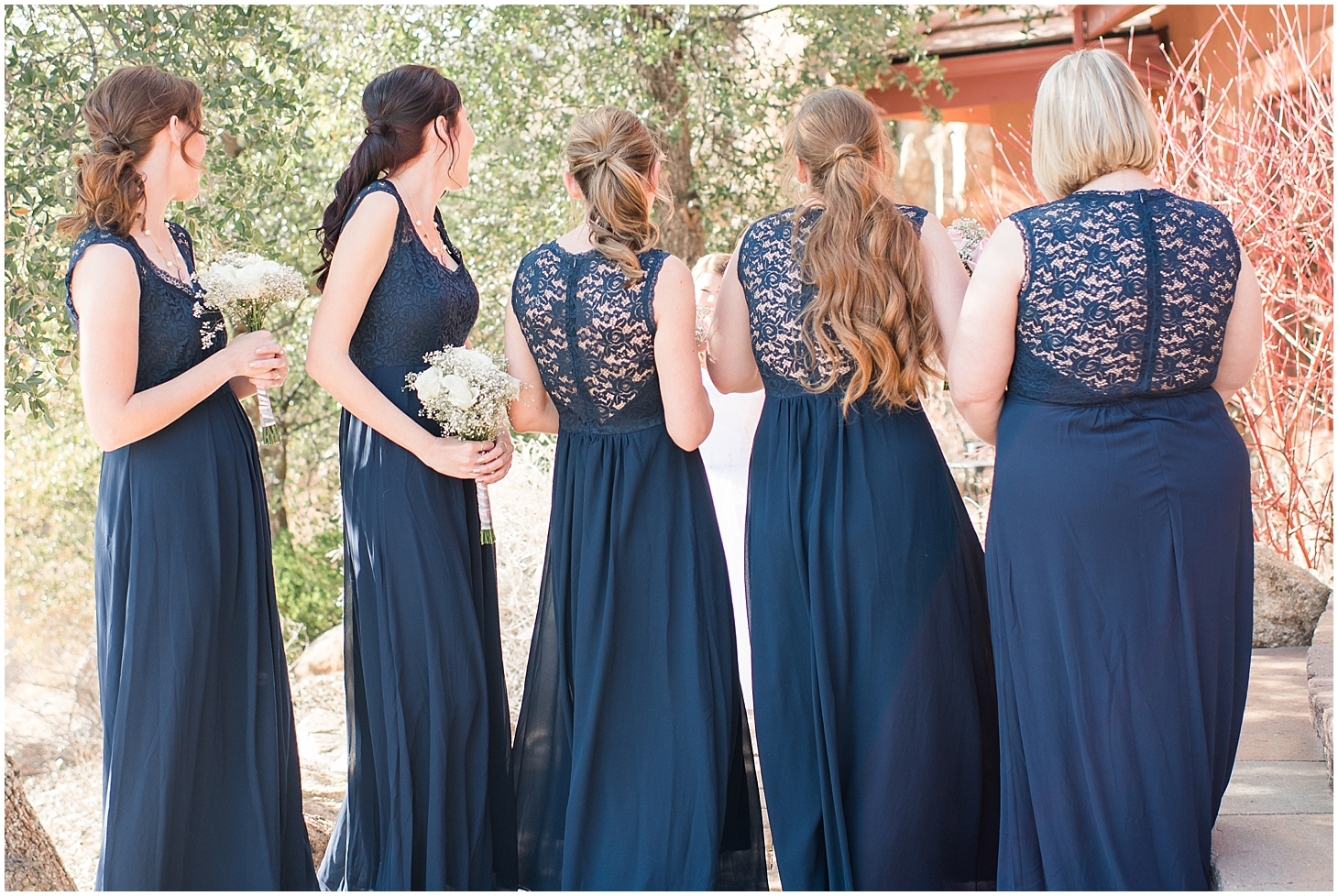 The bride opted to do a 'First Look' with her bridesmaids, which I thought was such a unique change!