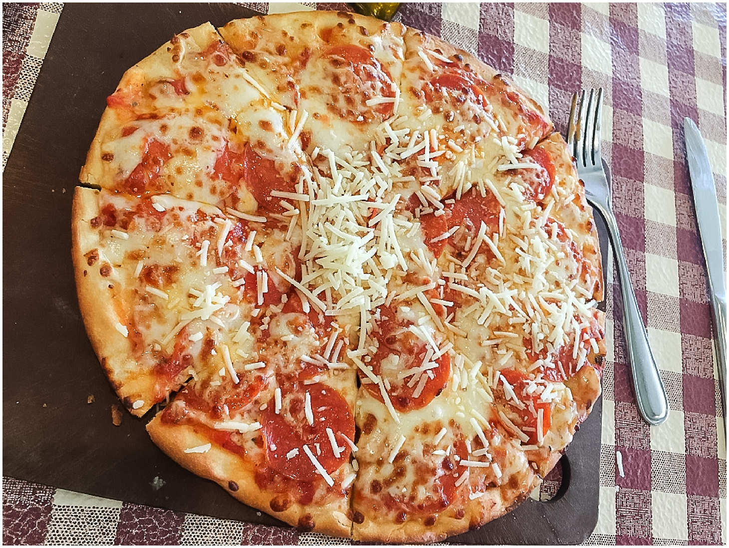 Pepperoni pizza from Zia's Caffe in Kaheohe, Hawaii. Photo by Jade Min Photography.