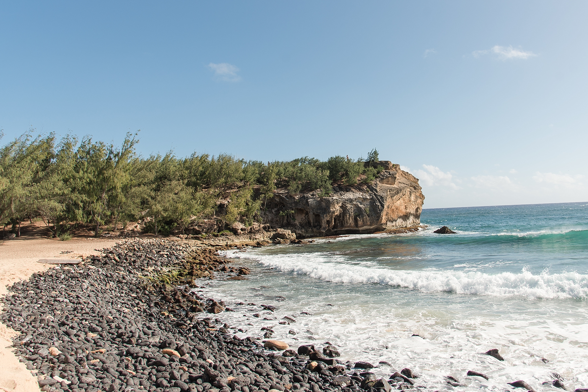 Shipwreck Beach in Poipu, Kaua'i Hawai'i. Photo by Jade Min Photography.