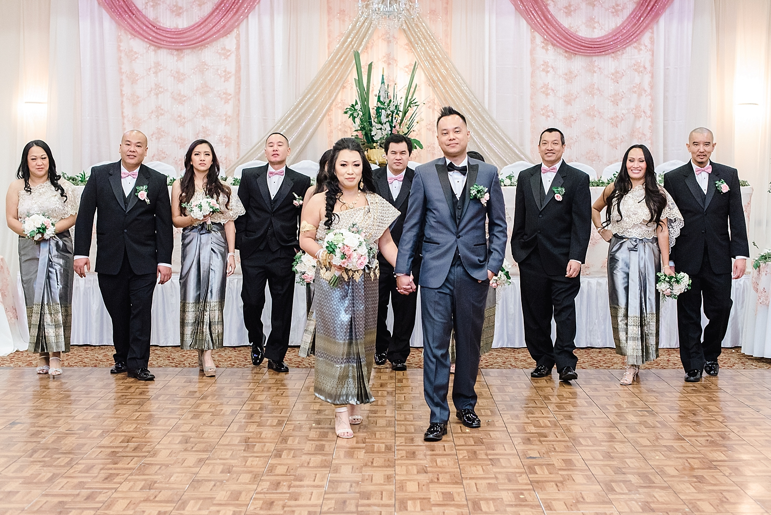 The final stage of the wedding involved family members and friends tying the bride and groom's left and right wrists with blessing strings, offering praises and well-wishes of happiness, good health, success, prosperity, and long-lasting love.