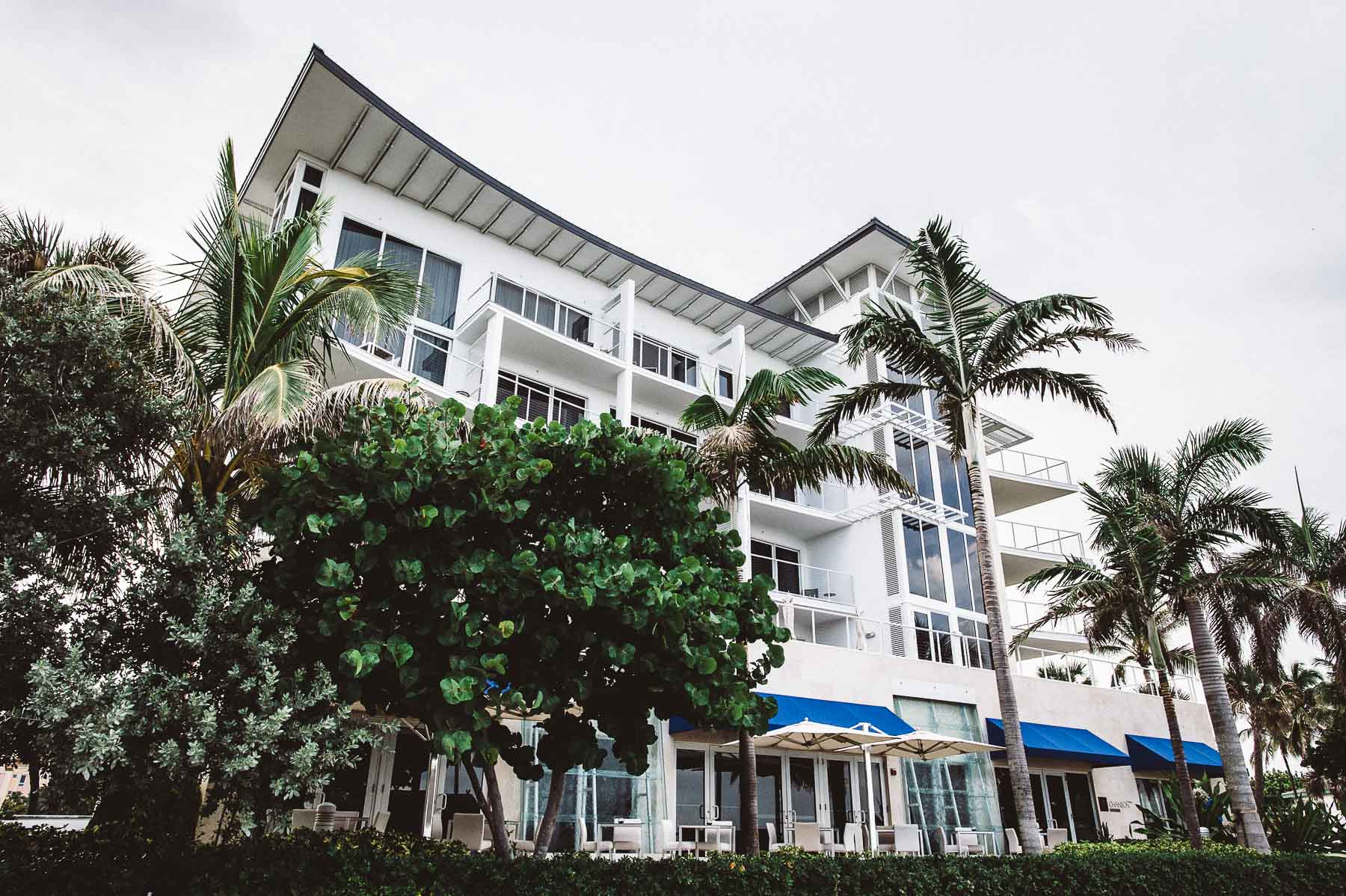 Exterior of The Royal Blues Hotel on a cloudy South Florida day.