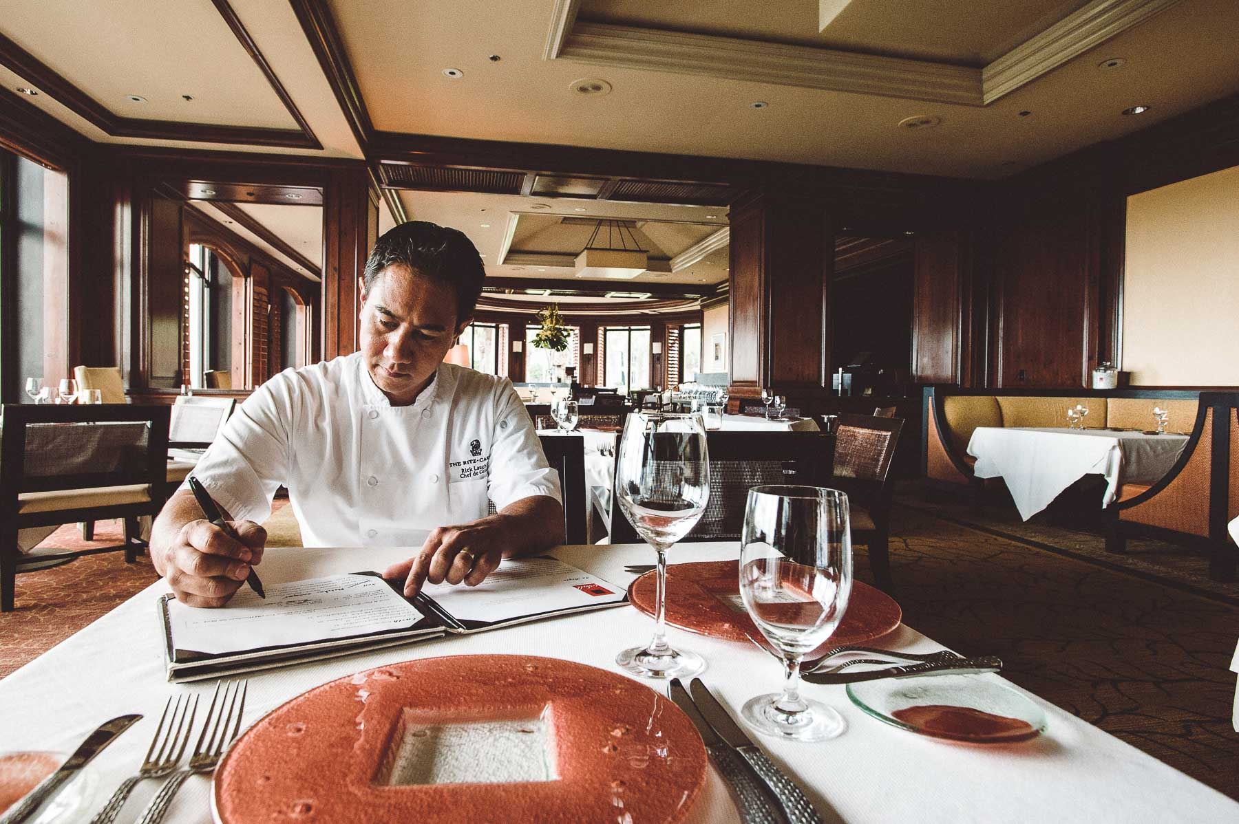 Chef Rick Laughlin prepares the evening's menu at Salt the Ritz-Carlton, Amelia Island, Florida.