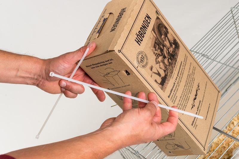 Använd buntband, ståltråd, snöre eller dylikt