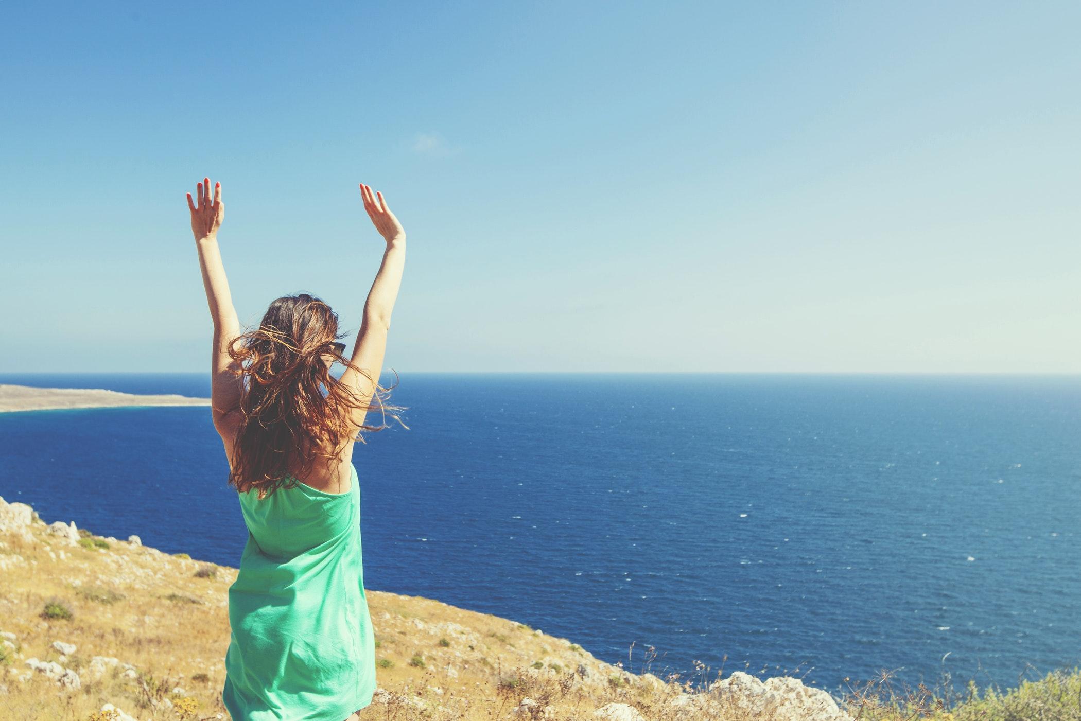 happy blue ocean woman beach wellness.jpeg