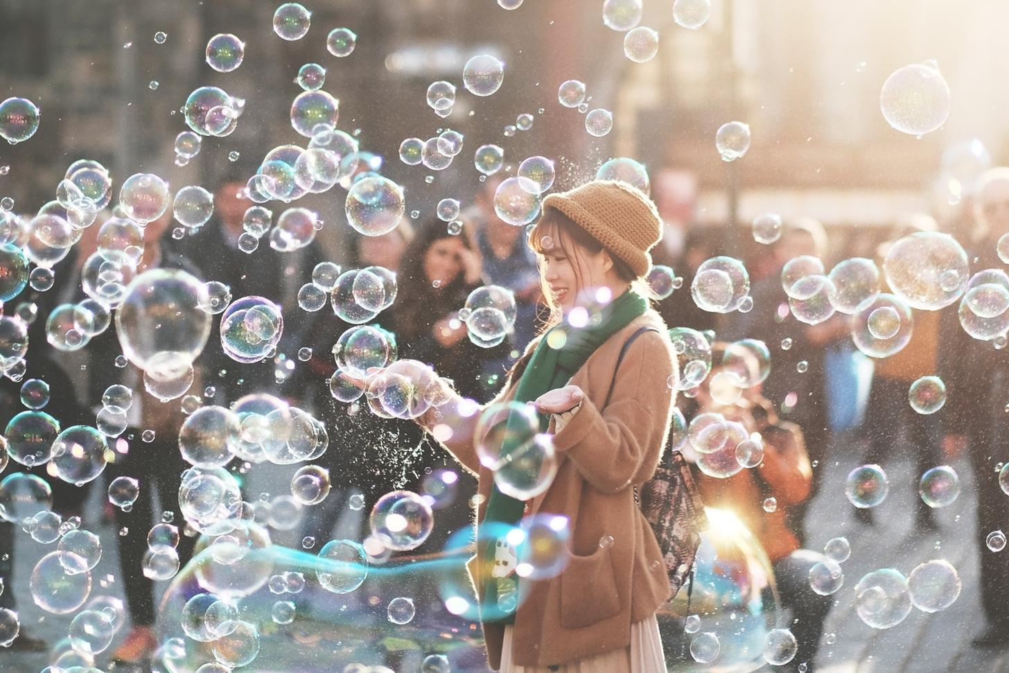 bubbles woman daytime group people happiness.jpeg