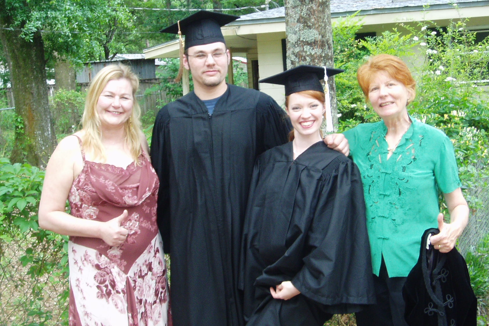 My graduation from college, 2005. (Left to Right: Mother-in-Law, Husband, Me, Mom)