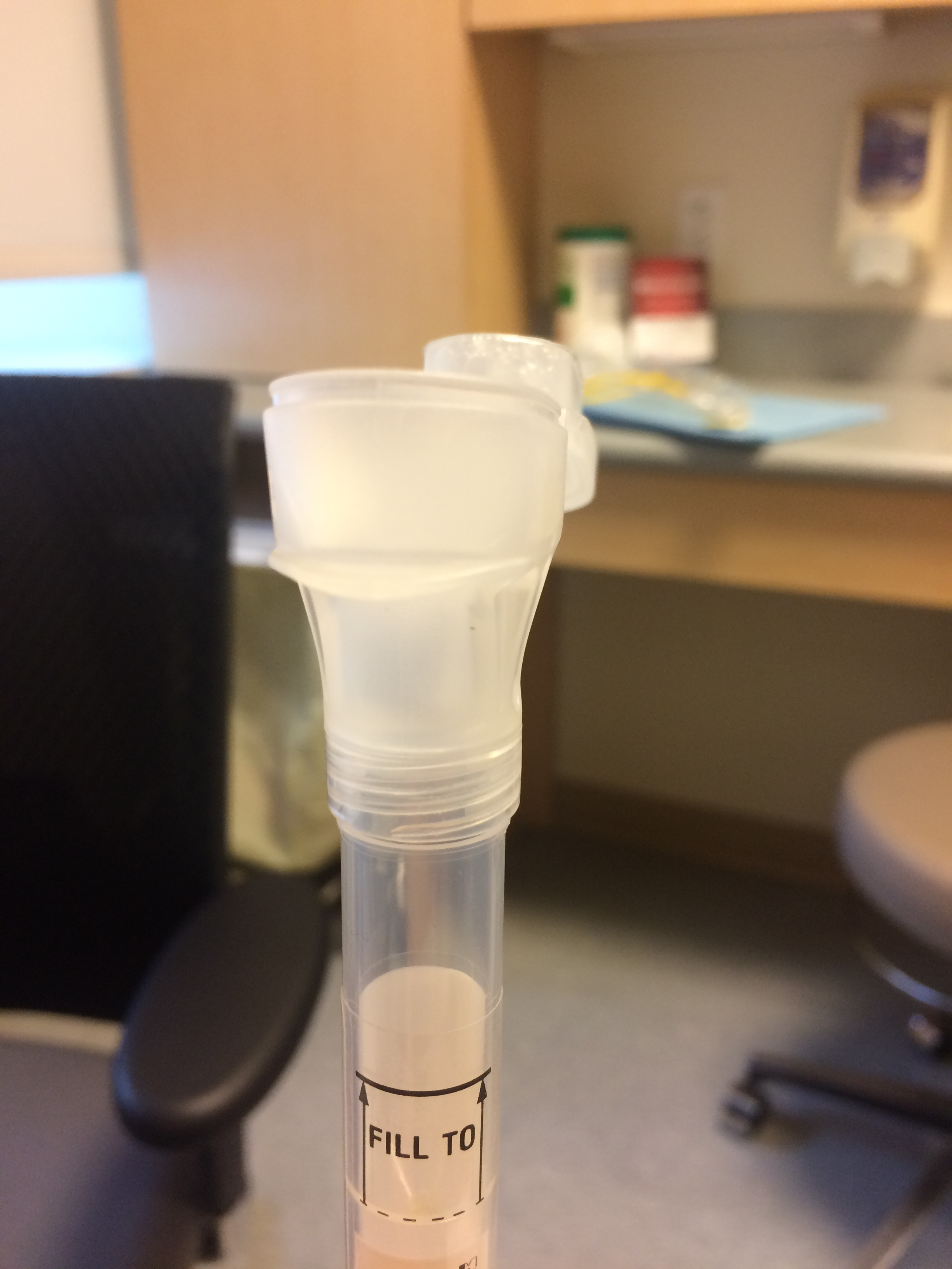 Getting genetic testing requires a lot of spitting in a tube!