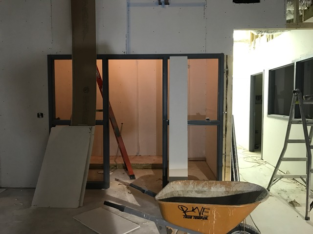 These are the frames for the windows and door to the ICU.  This is directly off of our main treatment room, so we can keep an eye on every pet at all times while they are recovering from surgery.  To the right, you can see the windows to the surgical suite.