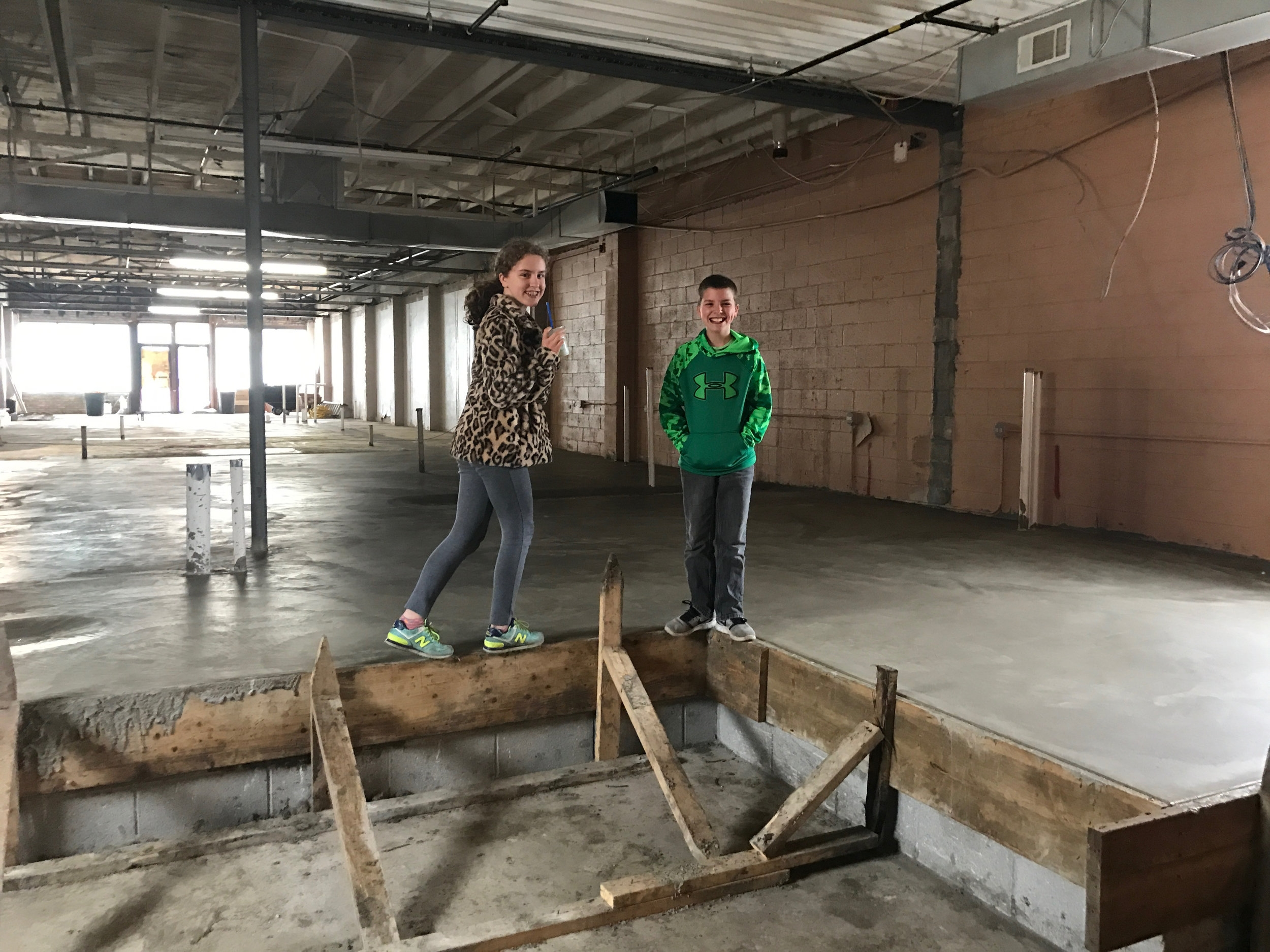 Madeline and Gavin on the construction site of the Veterinary Hospital in Westmont, IL