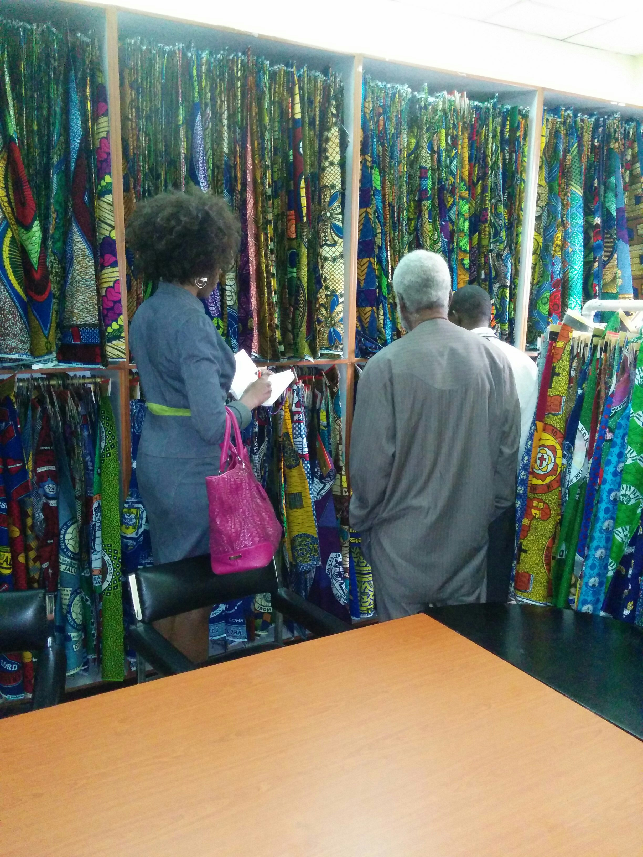 Ngozi Okaro selecting fabric