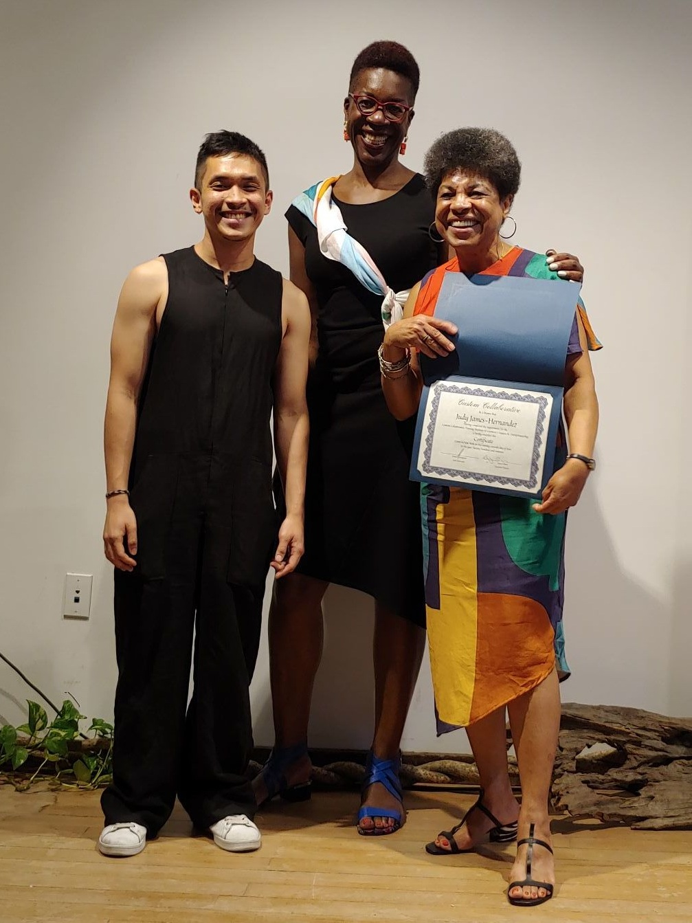 Graduate Judy James-Hernandez receives her certificate in garment construction and entrepreneurship from Lead Instructor Daniel Concepcion and Executive Director Ngozi Okaro. Training Institute Cohort 6 Graduation Celebration & Fashion Show June 27, 2019 at Mara Hoffman.