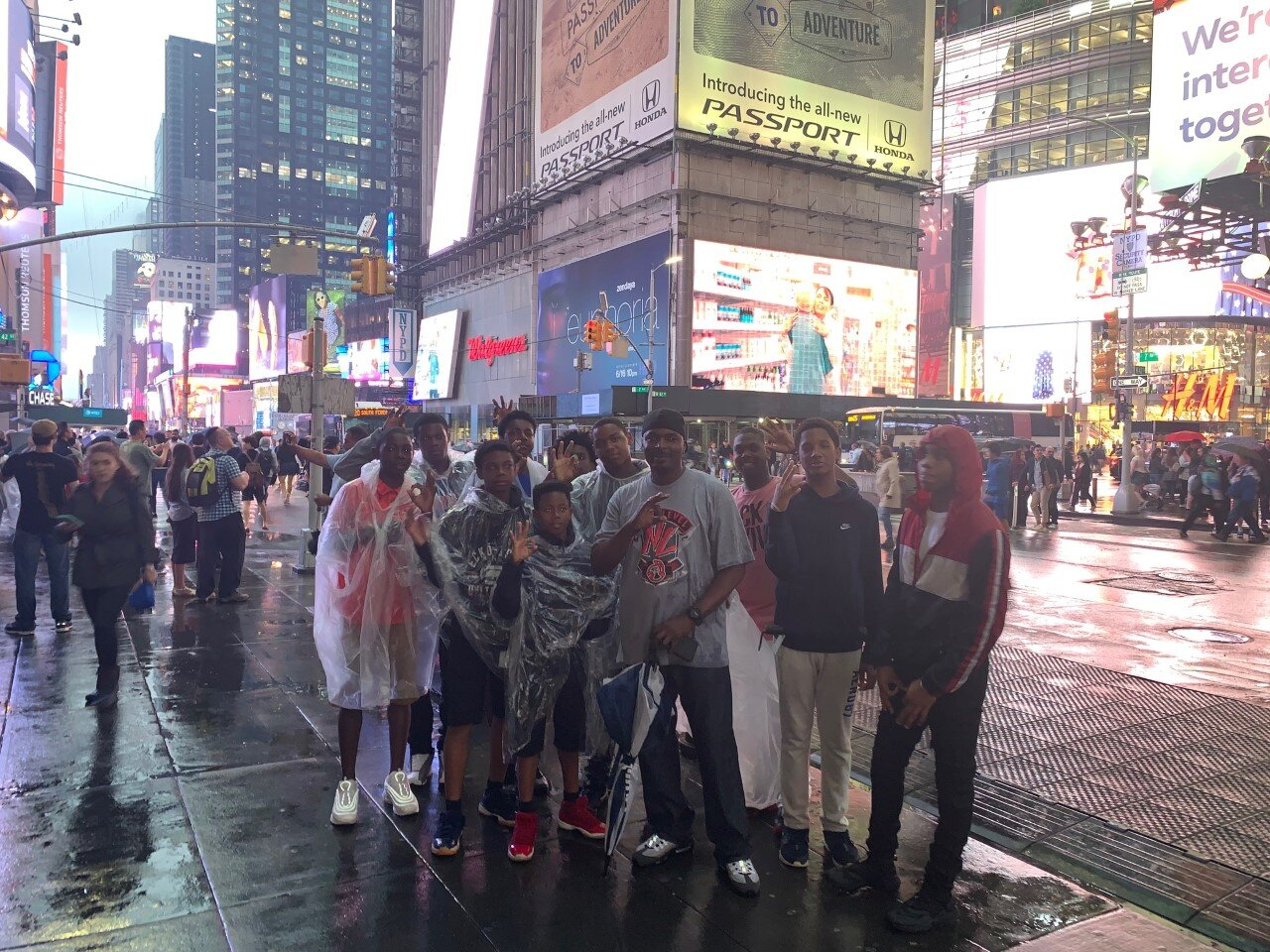 - Officer Harris with the boys at Times Square in New York City