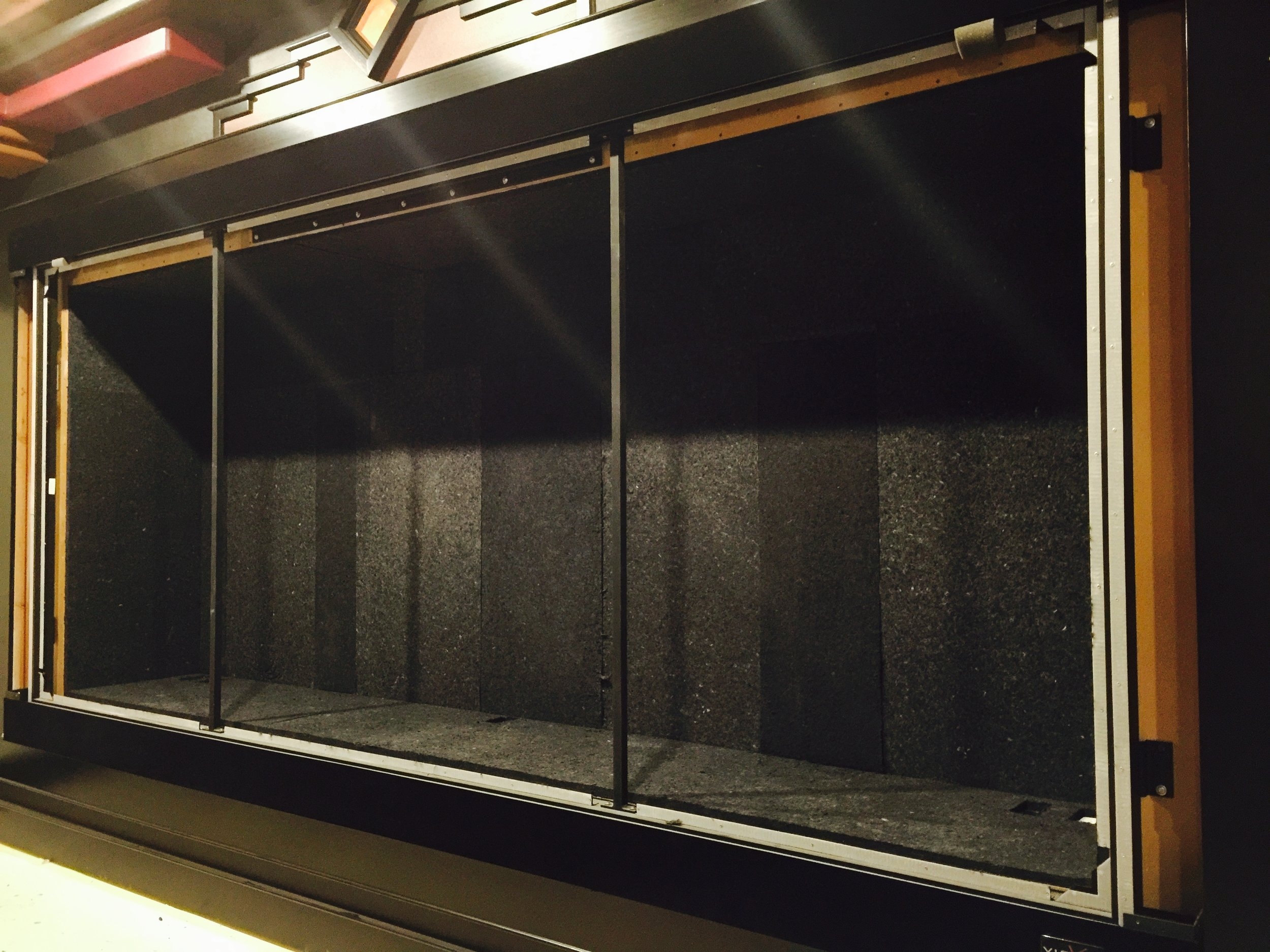 Video screen frame in place, perforated screen allows ideal speaker placement
