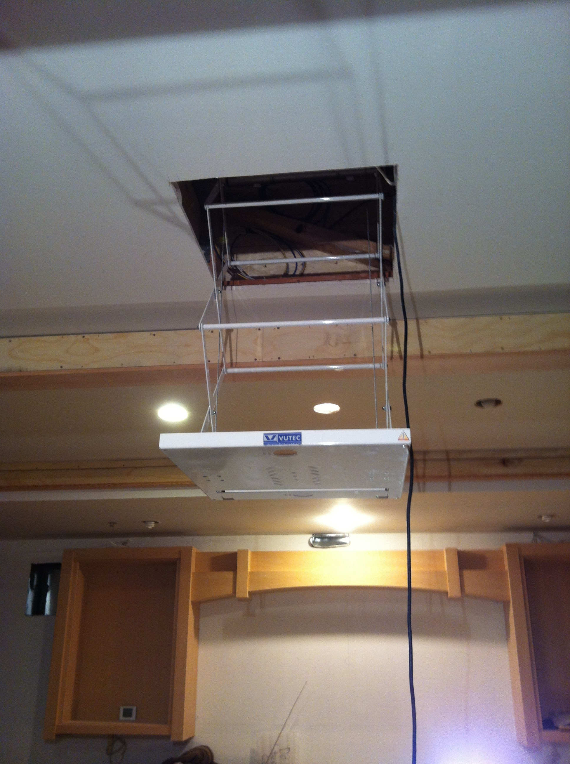 VuTec motorized lift takes protector all the way up and out of the room.