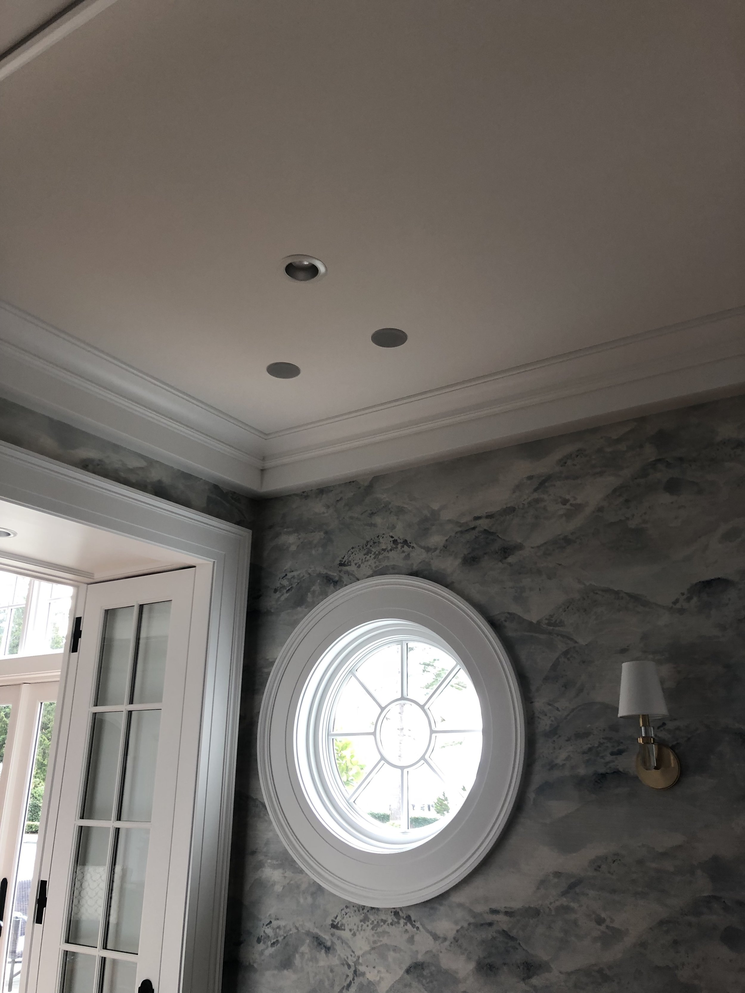 Very small, and matching the fixtures, this is a great detail. Here we feature very small aperture in-ceiling speakers, including subwoofer.