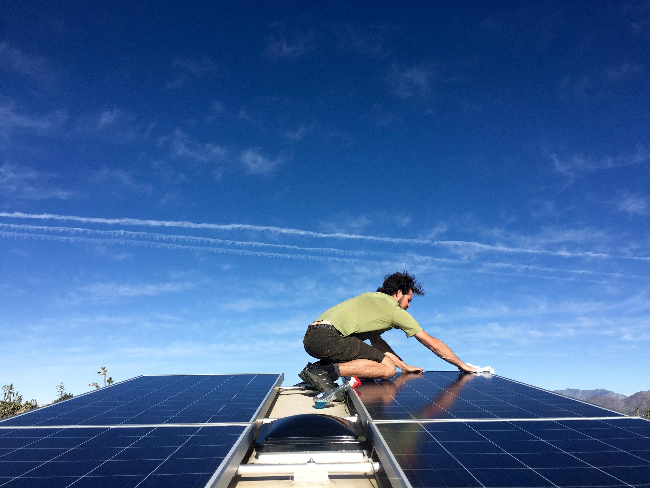 LSRF Jerud cleaning solar panels.jpg