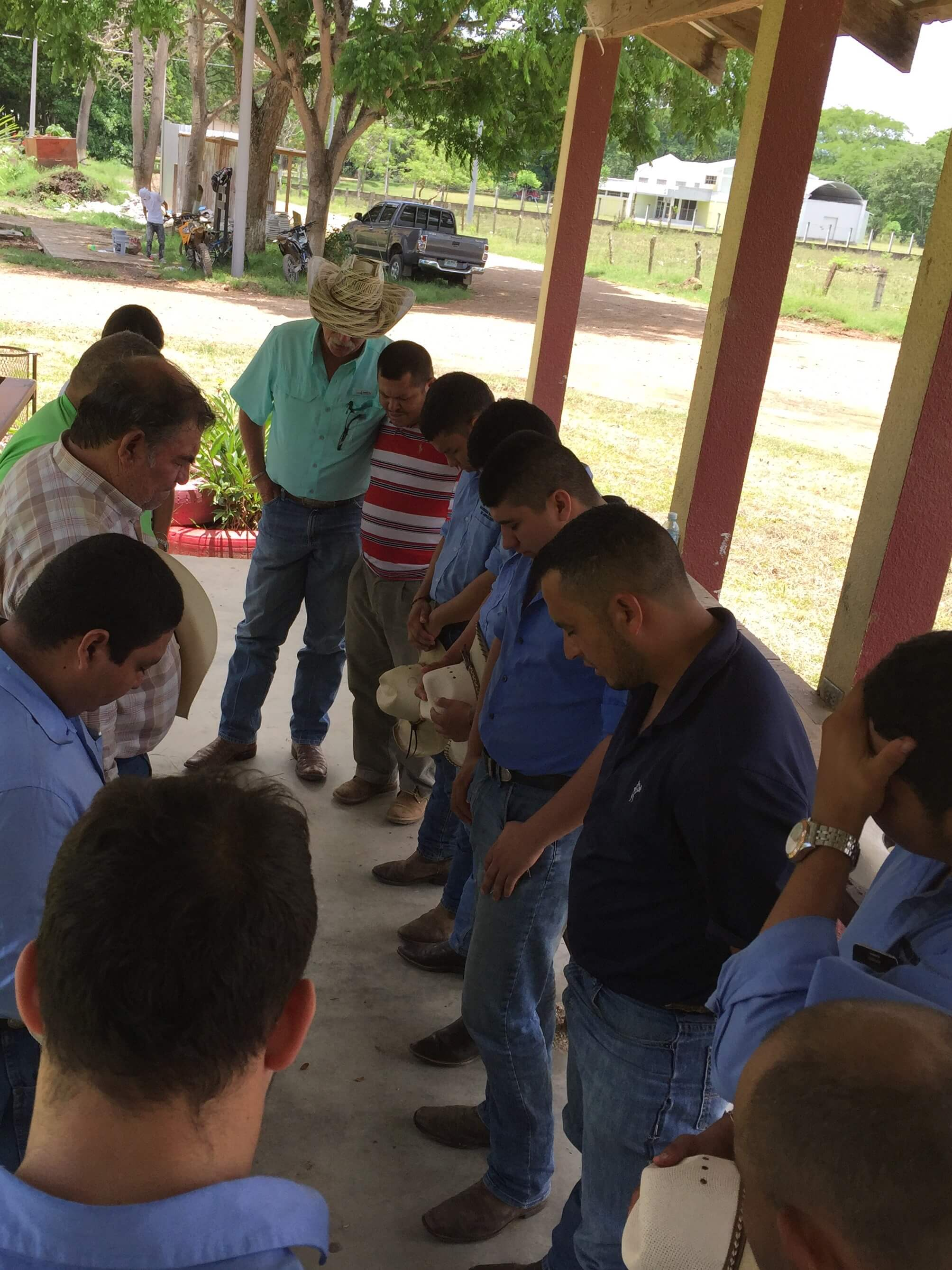 Prayer with the bull riding team of the National University of Agriculture