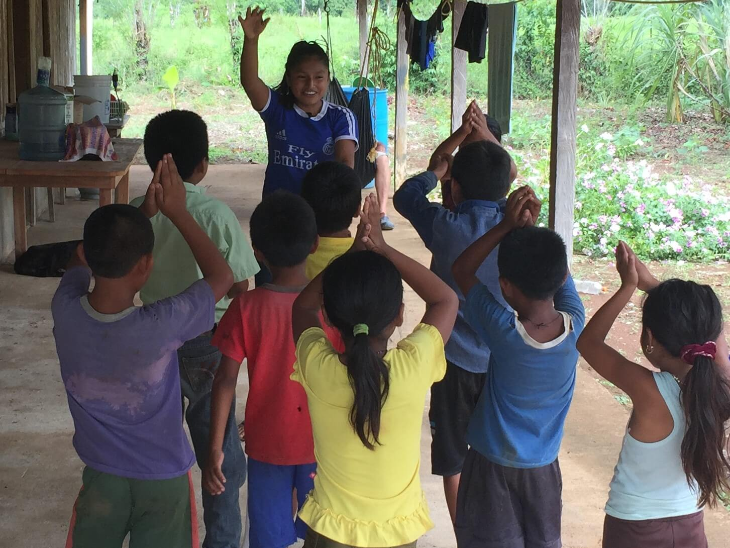 Clarita, the grand-daughter of one of the Kekchi pastors, leads kids in a song about a shark.