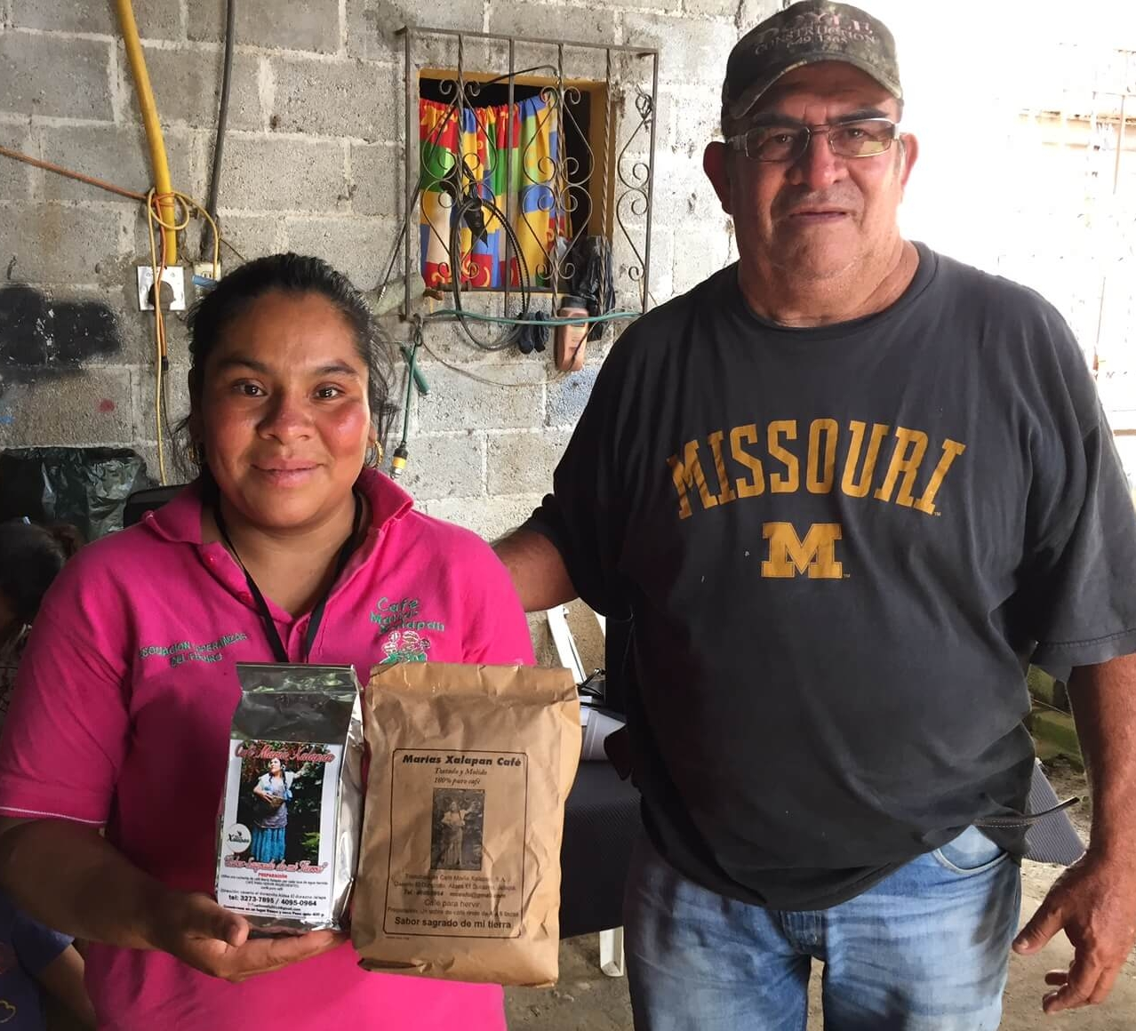 Cesar with Mirna as she shows us the coffee produced from her village