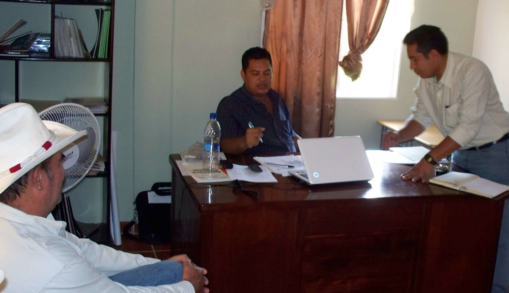 In 2011, Cesar discusses with Kenny Najera (seated behind the desk) of what it would entail for us to have a connection with the National University of Agriculture in Catacamas Honduras.