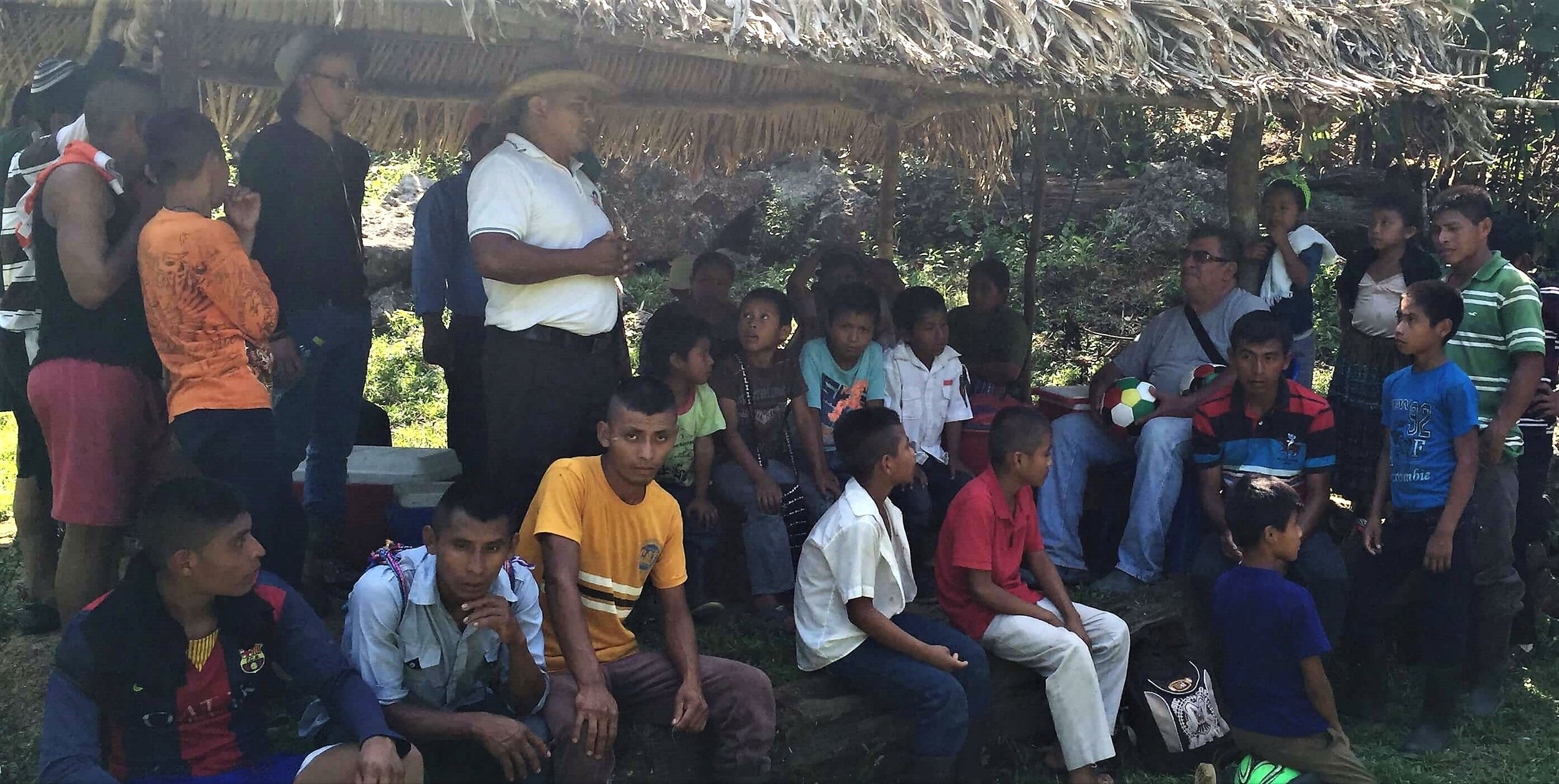 Jose (in the white shirt), pastor of the church in the village of Sepoc in the jungles of Guatemala, speaks to a group of soccer players after a tournament between four villages in March of 2016.