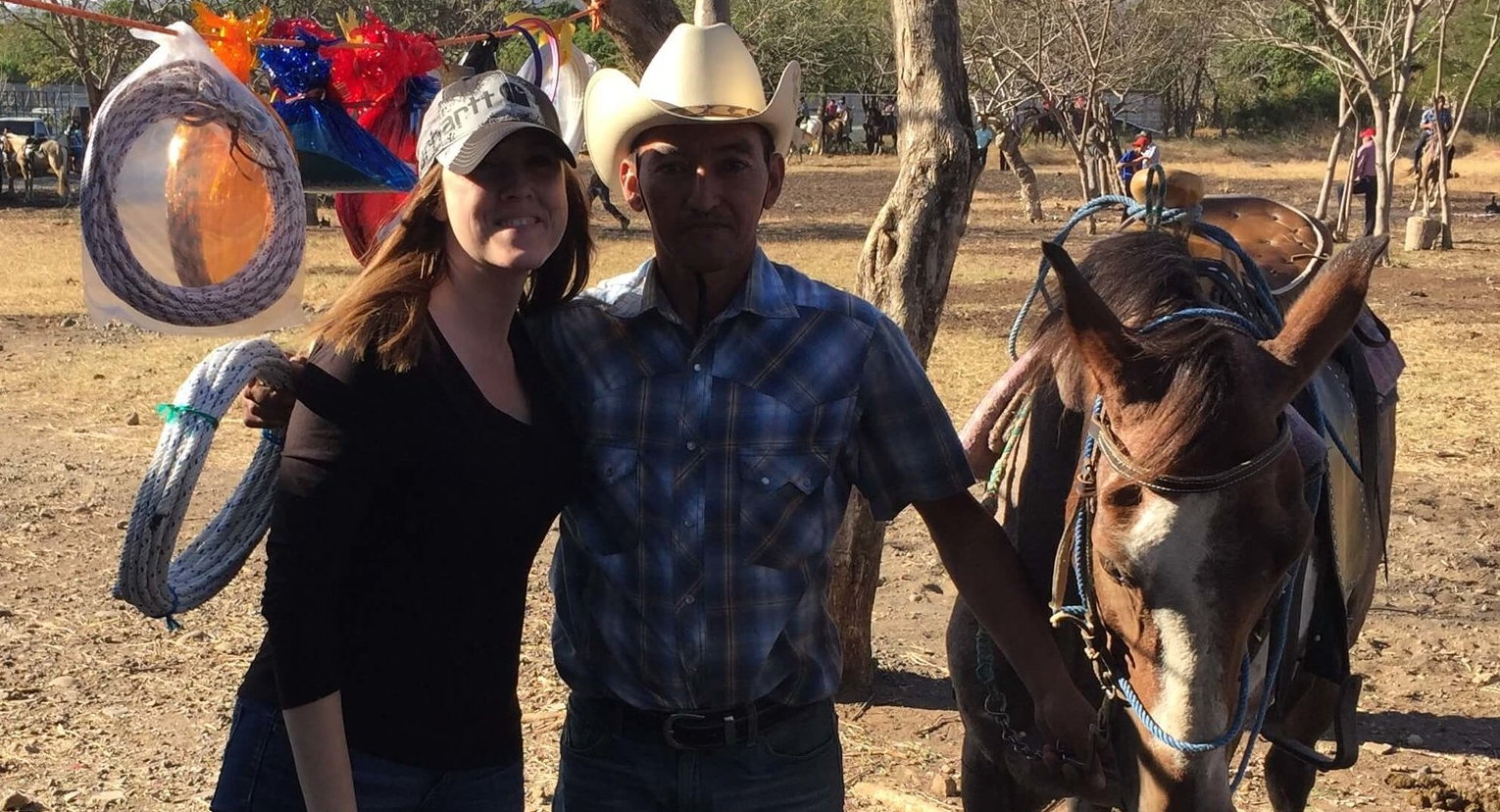 Laura Slaughter poses with a cowboy for a picture after giving him a prize of a rope. And yes, she did give him a kiss on the cheek!