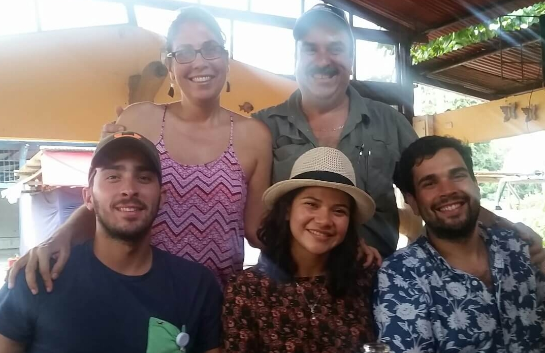 Alex and Joanna Salazar pose with their two sons, Alejandro and Alan along with Alan's girlfriend.