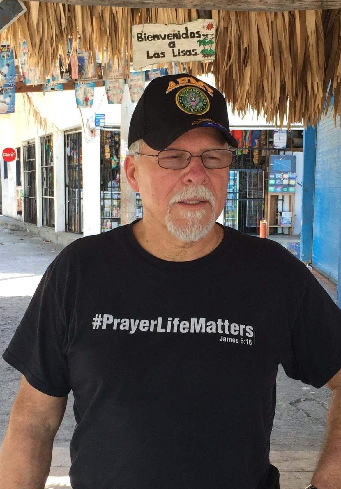 Ray Gurney talks about his trash idea while walking through a beach community in Las Lisas, Guatemala.