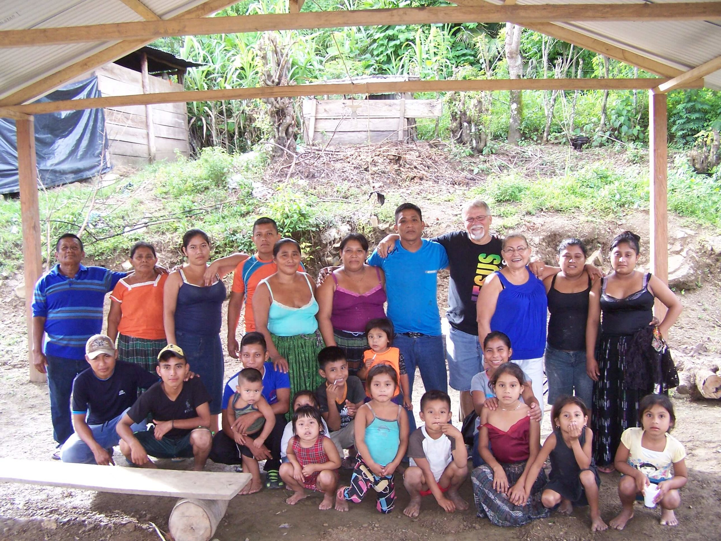 Ray Gurney poses with the nucleus of a new church in Sejux, Chahal, Guatemala, standing under their church's new roof.