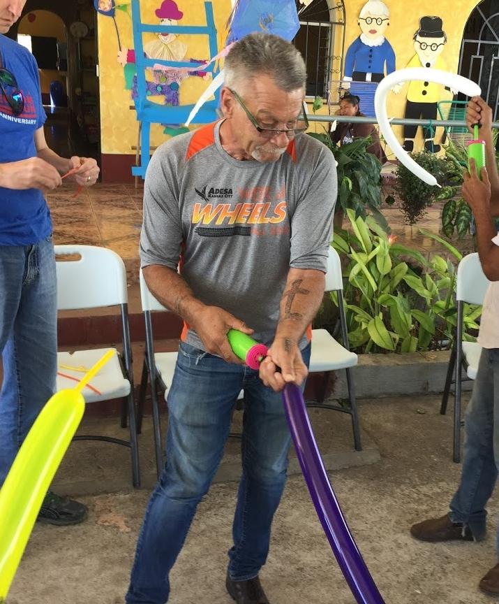 Joe helps keep everyone supplied in balloons at a senior citizens center near Quesada, Guatemala.