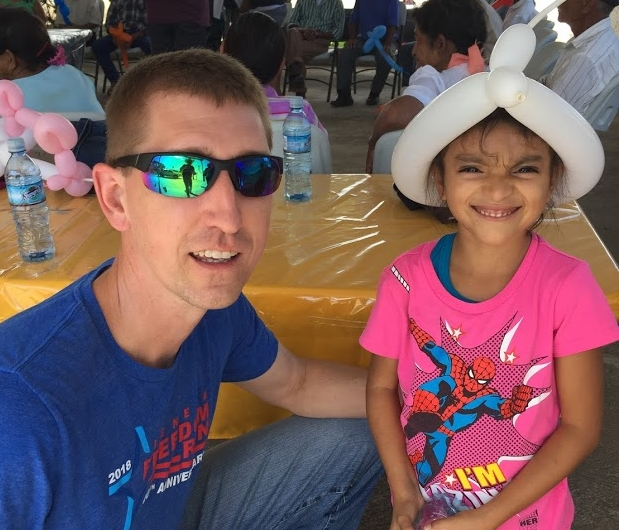 Ty shares a moment with a little girl in Quesada.