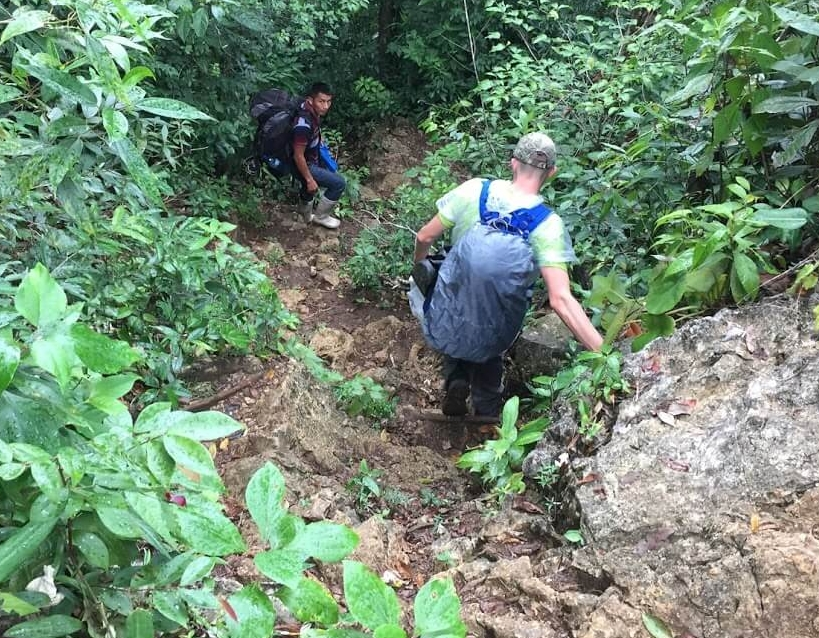 It's almost impossible to capture the perspective of how steep this trail gets. I'm looking almost straight down to take this picture of Aden and our friend Cesario, who is carrying my backpack.