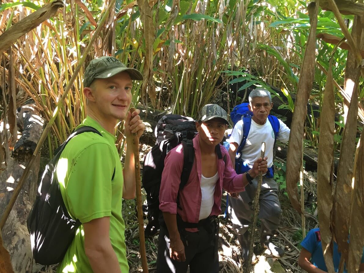 Going under the cardamom plants, Lorenzo wants to show us how they harvest the berries.