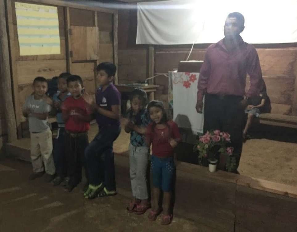 Lorenzo helping lead the children as they sing for the congregation. After this I got involved in the service and forgot to take any further picks!