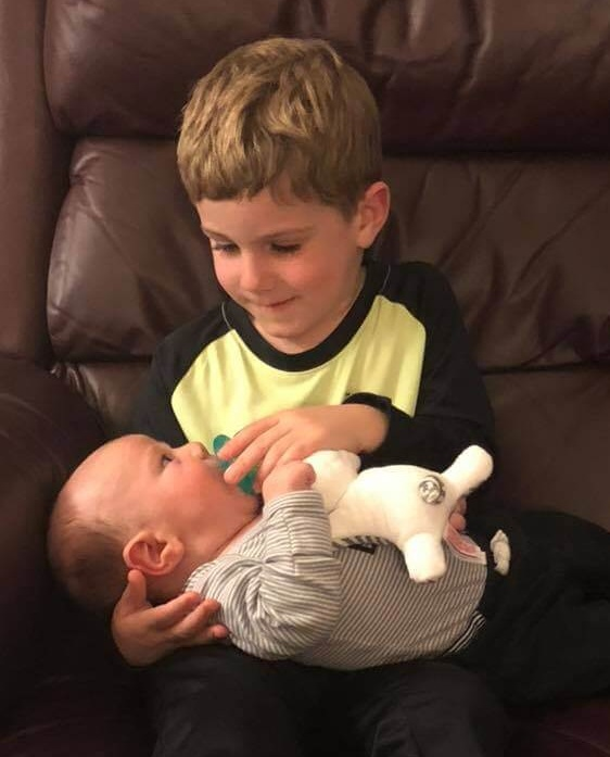 Brayden does his big brother routine with Landon.