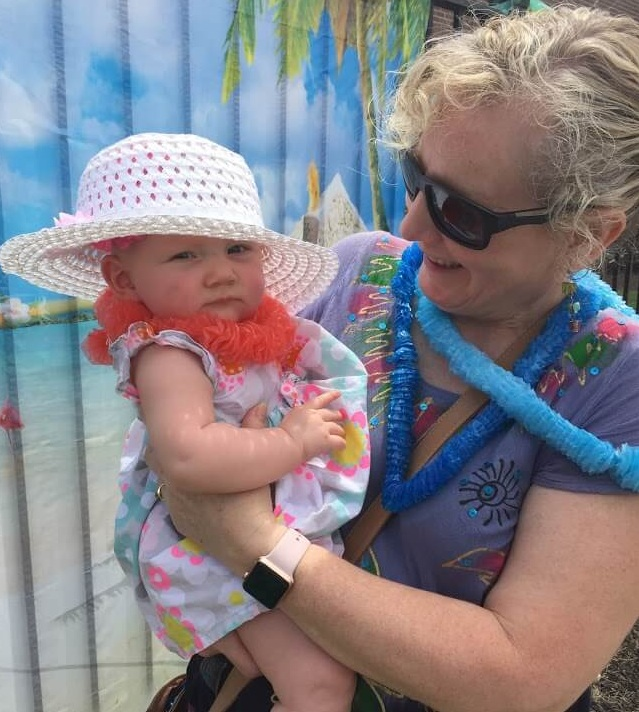 Bridget goes Hawaiian this past summer at her Mom's daycare.