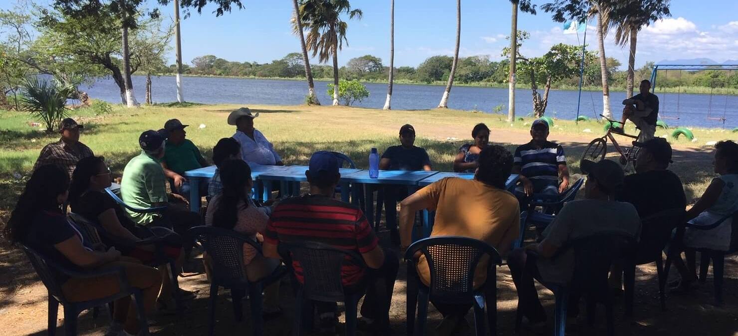 Another PSE group meeting under a tree near San Pedro Alvarado. In asking what this group could do for the community, they discussed working with local officials to help clean up the area around the lake.