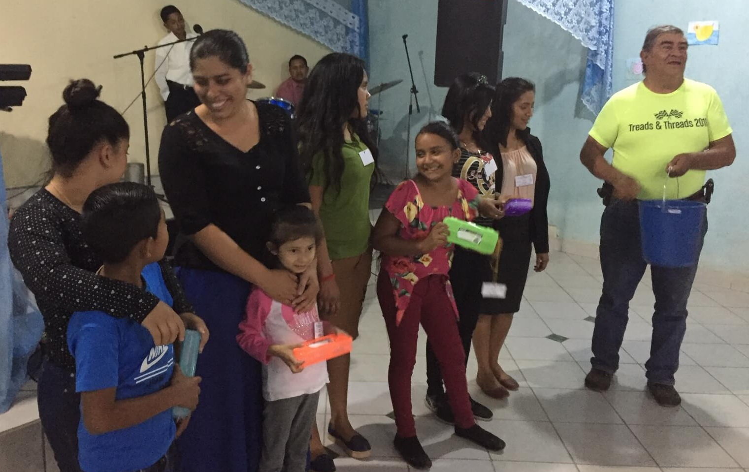 In a children's event at a church near Cesar's home in Amberes, these teachers enjoy a moment when Cesar gives prizes for various children who participated in the story time.