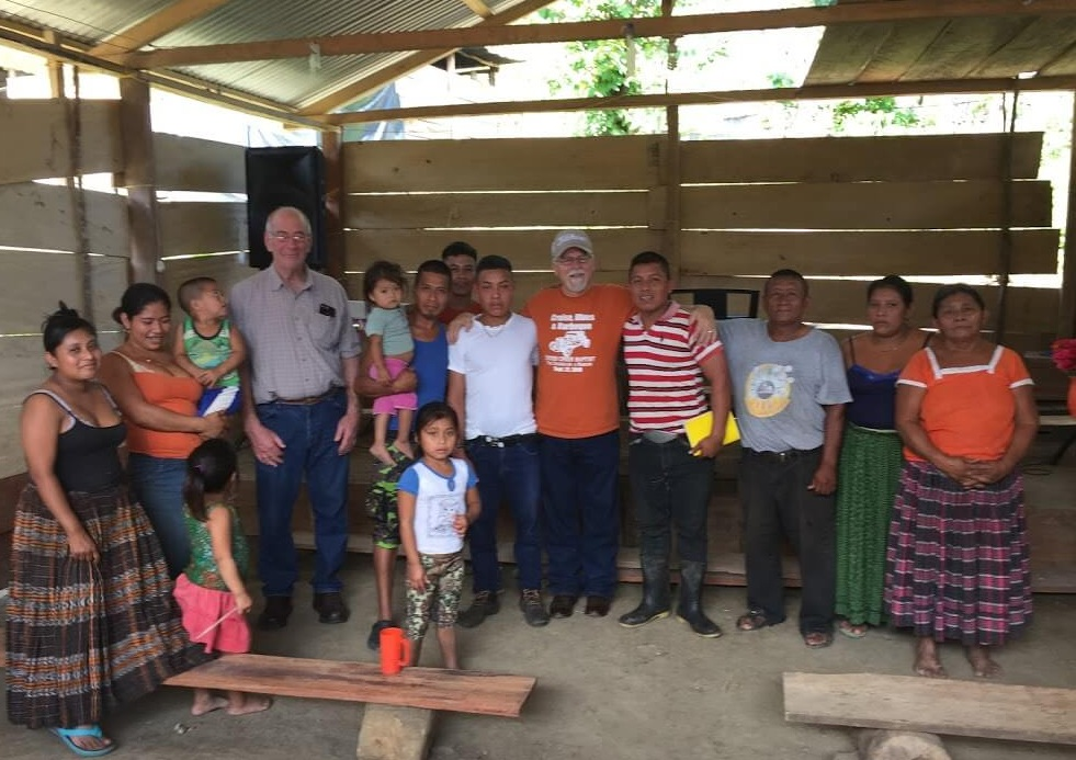 Rex Kelley and Ray Gurney pose with the nucleus of a new church in the jungle. The pastor is not pictured here, but in private he told me that he was seriously considering joining a family member in the U.S. working on a roofing crew. Please pray the pastor stays to lead this flock!