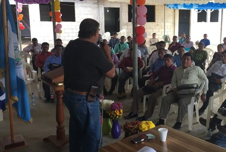 Cesar speaks to a group of Kekchi pastors at their annual meeting in January to invite them to come back in May for training.