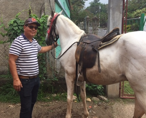 Humberto poses with our new horse!