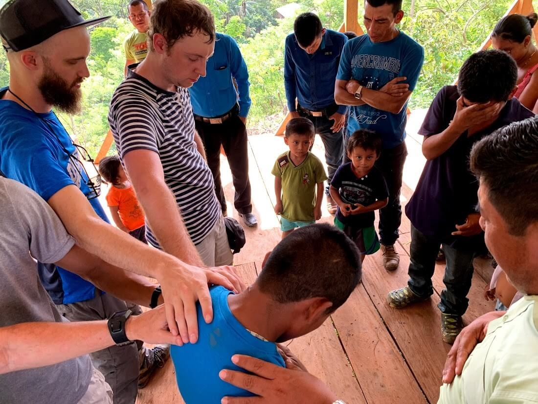 After sharing faith stories, this young man asked if someone would help him become a follower of Jesus like the others in this new church. Here, German is leading him in a prayer of salvation as we prayed together with him.