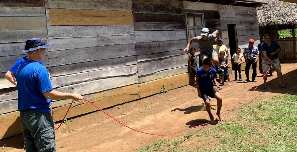 In this village in Raxaha, Todd and Cesar turn the rope while Joe and a Kekchi boy try to jump together.