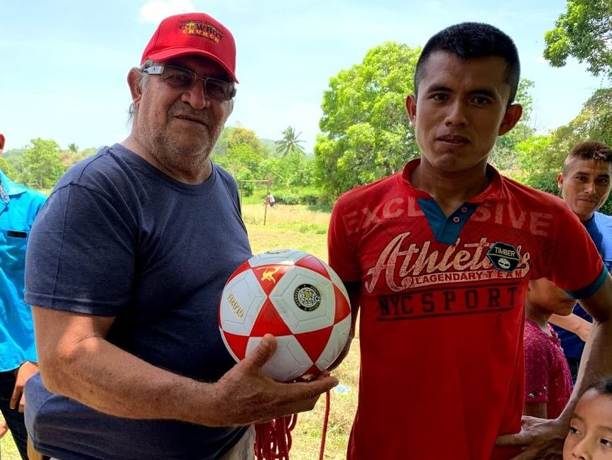 After playing soccer in Raxaha, we agreed to bring a team in the future for a four-team tournament. Here Cesar presents a ball to the organizer of the village's soccer teams.