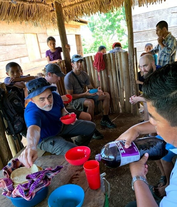 After playing soccer in Raxaha, the church ladies fixed us a meal of beans and eggs and tortillas. With no utensils, the custom is to use the tortillas to scoop the food into your mouth. Here Todd is getting another tortilla to help in his efforts!