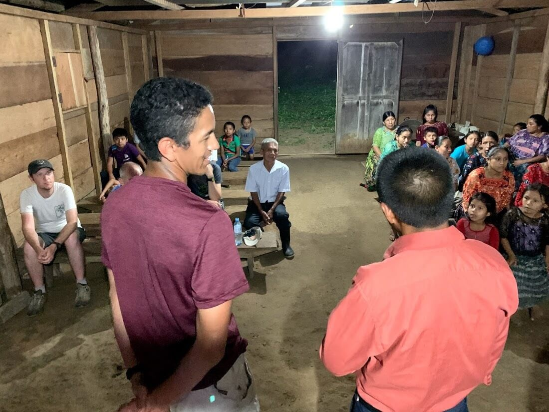 After a hard day of hiking to Ochul Choch, the team shares in a worship service. Here, Joe shares his testimony while Lorenzo translates it to Kekchi.