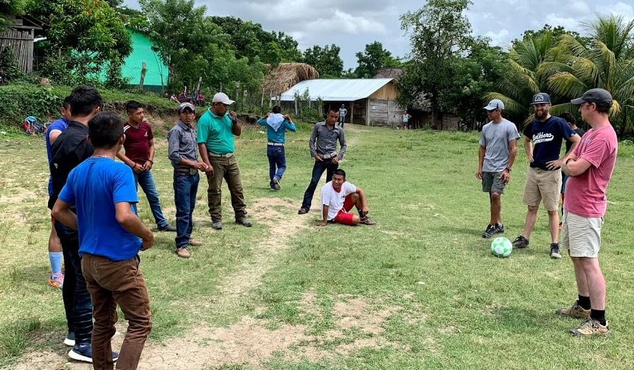 In the village of Ferial, we get ready to play soccer with a group of men and boys. After the game we sat on the field and shared stories. This opened up a whole group of unbelievers to the church that we were working with on that day.