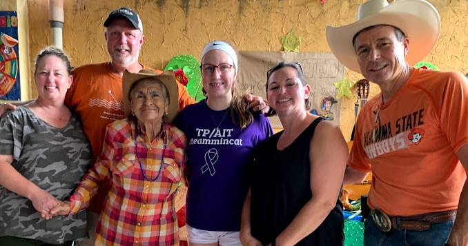 "On our first day, we met with the seniors center of Santa Cruz Naranjo. Here our team posed with a dear lady from the center. From left to right is Dawn Farrill, her husband George, 16-year-old Alexandra ""Alex"" Catron, Belinda Burkhardt, and me."