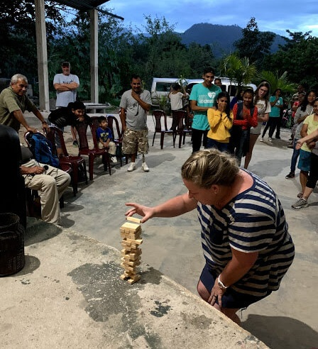 At a youth group gathering of Iglesia Mision Damasco (Damascus Mission Church) in Rinconcito, Guatemala, Dawn delicately placed her piece on the top of the Jenga tower as her team looked on. This youth group is planning a trip to the jungle this year to help with our work there.