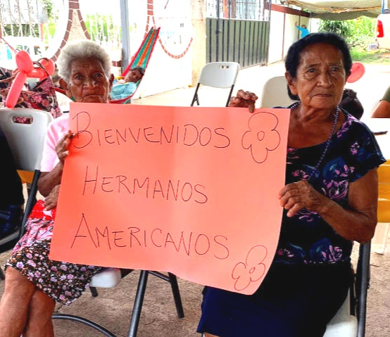 "At the seniors center in Quesada, these ladies made a sign to welcome us. It says, ""Welcome American Brothers."""
